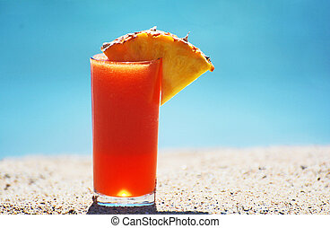 a tropical fruit drink at the beach