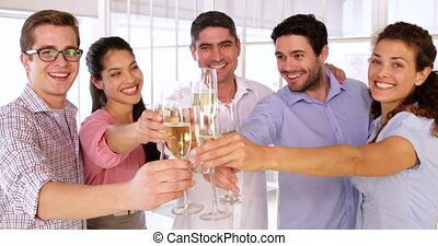 designers celebrating with champagne - Gleeful designers...