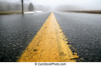 Wet Road - A low perspective view of a wet, foggy road.