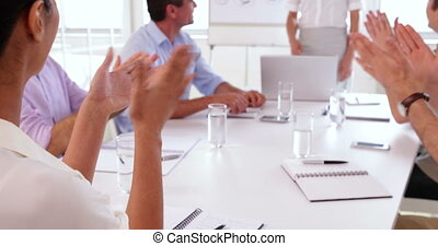 Business team applauding after a presentation in the office