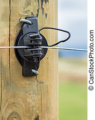 Electric Fence Insulator - Black electric fence insulator on...