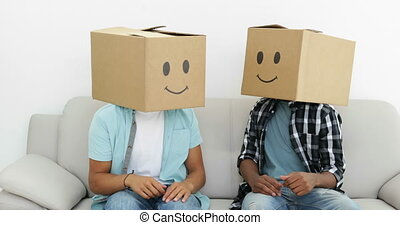 Silly employees with boxes on their heads giving thumbs up...
