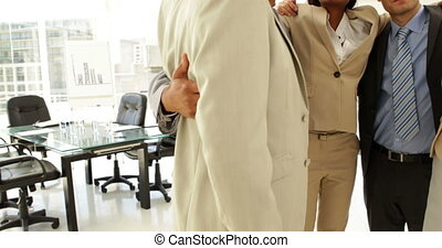Business people embracing each other at the office