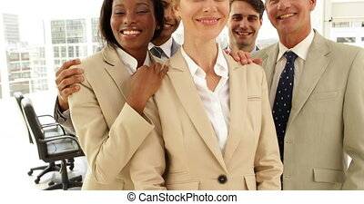 Business people hugging each other at the office