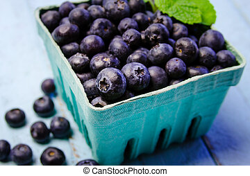 Fresh picked organic blueberries - Close up of blue carton...