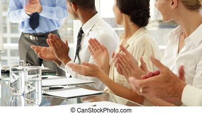 Business people clapping at presentation at the office