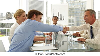 Business people shaking hands at a meeting at the office