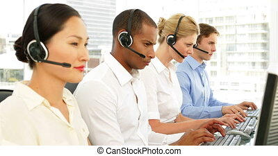 Call center agents working - Call centre agents working with...