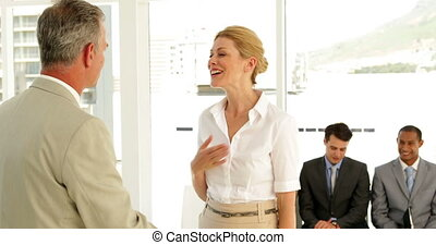 Businessman shaking the hand of job applicant and talking...