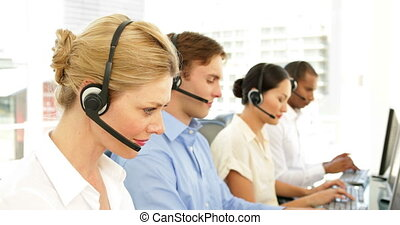 Call centre agent on a call at the office