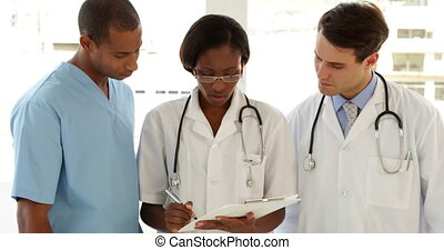 Happy medical team speaking about f