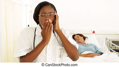 Nurse getting a headache in the ward at the hospital