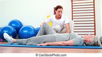 Physical therapist helping patient - Physical therapist...