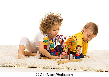 Two kids playing with wooden toy