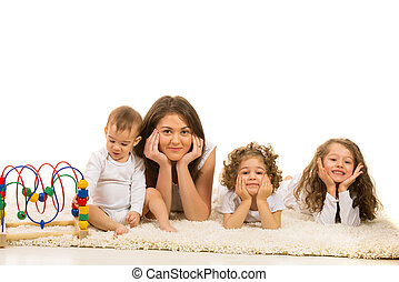 Beautiful family laying in a row on carpet