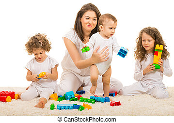 Beauty mom playing with her three kids home and sitting...