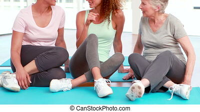 Three happy women chatting - Three happy women chatting at...