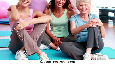 group of women in fitness studio - Smiling group of women in...