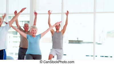 Pilates instructor smiling at cam - Pilates instructor...