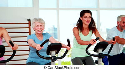 Fitness group doing a spinning - Happy diverse fitness group...