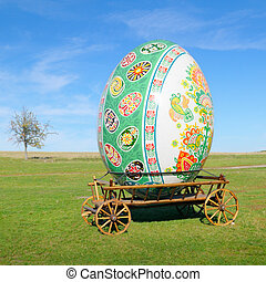 big easter egg on a cart in the open air
