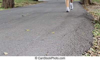 Woman runner running  in park