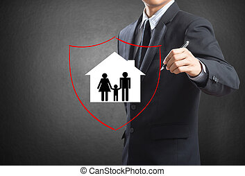 Shield protecting family and house - Business man drawing...
