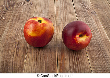 nectarines on a wooden background