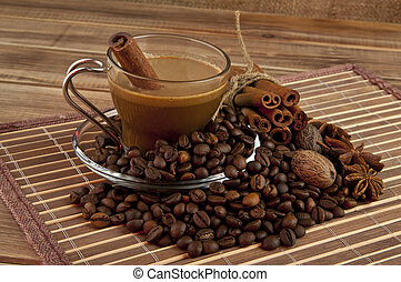 Cup of coffee, grains, and spices against the canvas