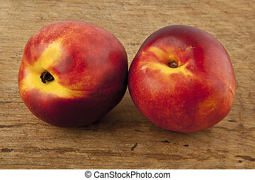 nectarines on a wooden table