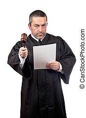 Judge reading a sentence - Serious male judge holding the...