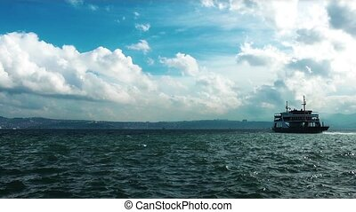Ferryboat is passing. The place is Izmir, Turkey
