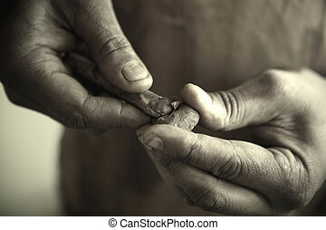 African Carpenter Restoring Antiques - A closeup of an...