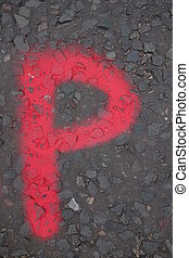 Letter P - Alphabet letter P in red paint on tarmac road