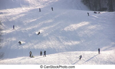 Ski Run - People Skiing And Snowboarding Down A Mountain