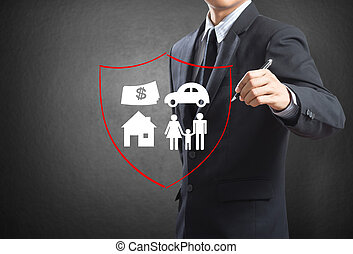 Insurance concept - Business man drawing shield protecting...