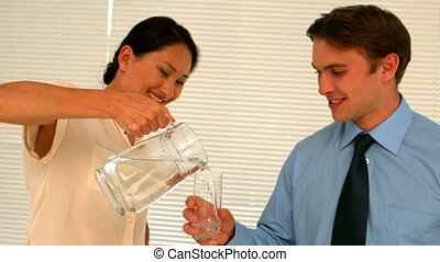 Businesswoman pouring her partner