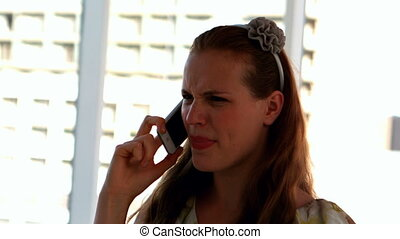 Pretty girl shouting on the phone - Pretty girl shouting on...