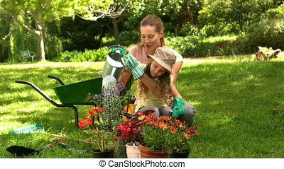 Little girl gardening with her mom