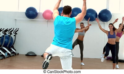 Aerobics class exercising together in slow motion