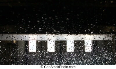 Many carwash car wash raindrops falling on the glass coming...