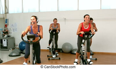 Spin class working out in slow motion
