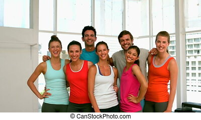 Fitness class smiling at camera