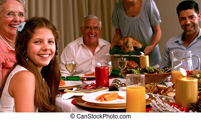 Family having christmas dinner at