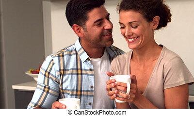Happy couple having coffee in the - Happy couple having...
