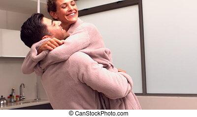 Man lifting and hugging his partner