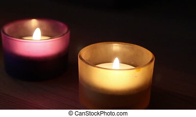 Four candles in the glass with different colors