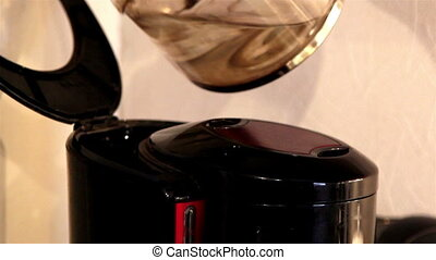 Pouring of water inside the coffeemaker