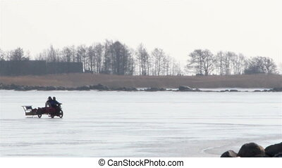 A motorcycle motorbike mobile car is so fast pulling a sled...