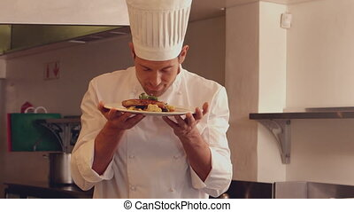 Chef smelling a dish in slow motion